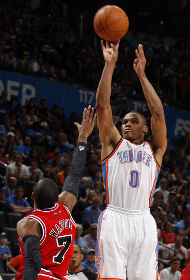 Oklahoma City's Russell Westbrook (0) shoots over Chicago's C.J. Watson (7) during the NBA basketball game between the Chicago Bulls and the Oklahoma City Thunder at Chesapeake Energy Arena in Oklahoma City, Sunday, April 1, 2012. Photo by Sarah Phipps, The Oklahoman