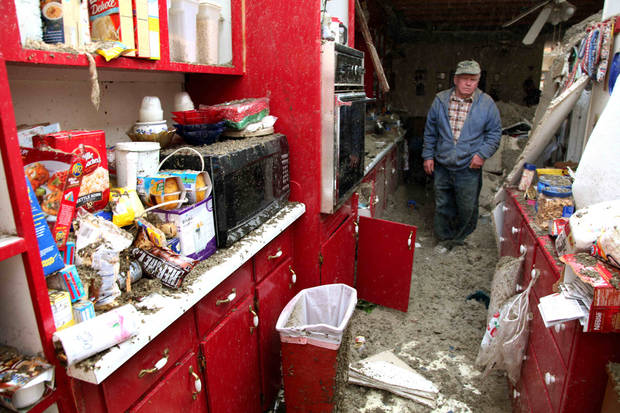 Blaine Lawson, 76, stands inside his house after a reported tornado tore the roof off his home, Friday, March 2, 2012, in Cleveland, Tenn. Neither he nor his wife were injured. (AP Photo/Robert Ray) ORG XMIT: TNRR102