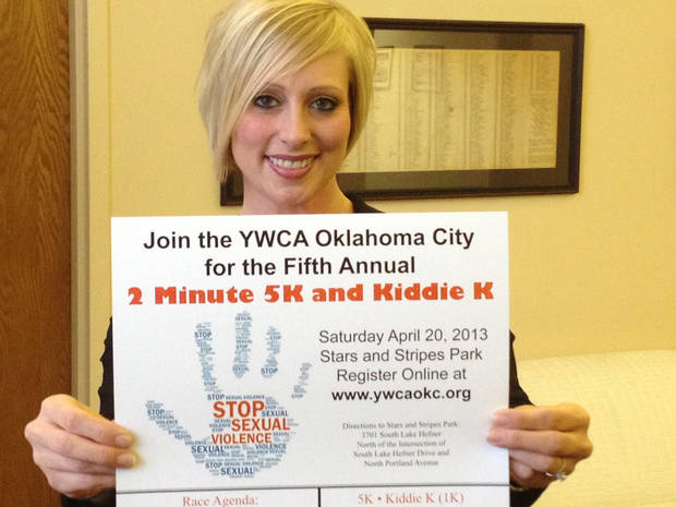 Karla Docter, the senior director of sexual assault services at the YWCA Oklahoma City, displays a poster for the event. Photo provided