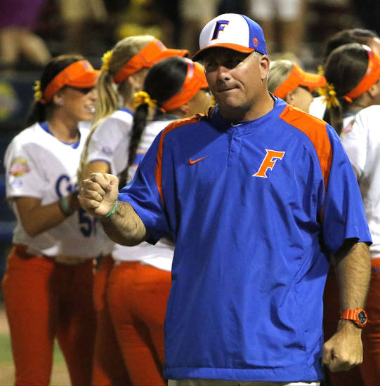 Florida's Coach Tim Walton celebrates a win behind his team during Game 1 in the championship series of the Women's College World Series between Florida and Michigan at ASA Hall of Fame Stadium in Oklahoma City on Monday June 1, 2015. Photo by Jackie Dobson, The Oklahoman.