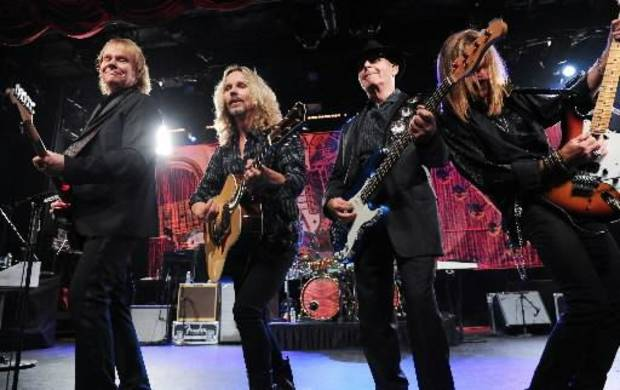 "From left, musicians James ""J.Y."" Young, Tommy Shaw, Chuck Panozzo and Ricky Phillips of the band Styx, perform at Eric Clapton's Crossroads Guitar Festival artist party at The Hard Rock Cafe New York on Thursday, April 11, 2013 in New York City, New York. (AP)"