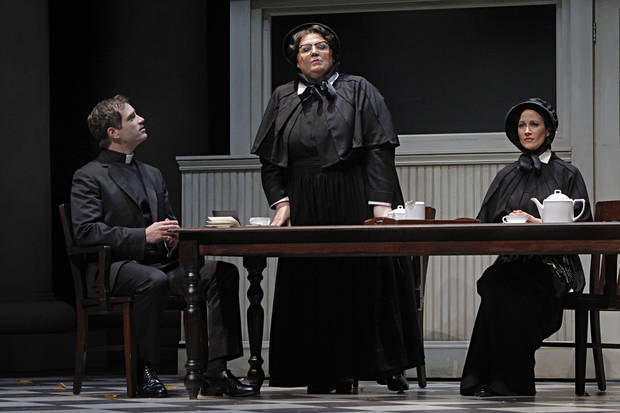 "In this Jan. 23, 2013 photo provided by the Minnesota Opera, Matthew Worth as Father Brendan Flynn, a parish priest, Christine Brewer, center, as Sister Aloysius Beauvier, the school principal and Adriana Zabala as Sister James, a teacher and a nun, perform during a dress rehearsal for the Jan. 26 world premiere of ""Doubt"" at the Minnesota Opera Center in Minneapolis. (AP Photo/Minnesota Opera, Michal Daniel)"