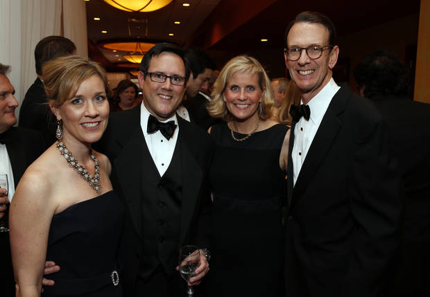 Ball executive director Marian Free and husband Ryan, left, and Ball Board President  Robert McCampbell and his wife Donna attend the Oklahoma Speaker's Ball at the Embassy Suites Hotel on Friday, Feb. 1, 2013 in Norman, Okla.  Photo by Steve Sisney, The Oklahoman