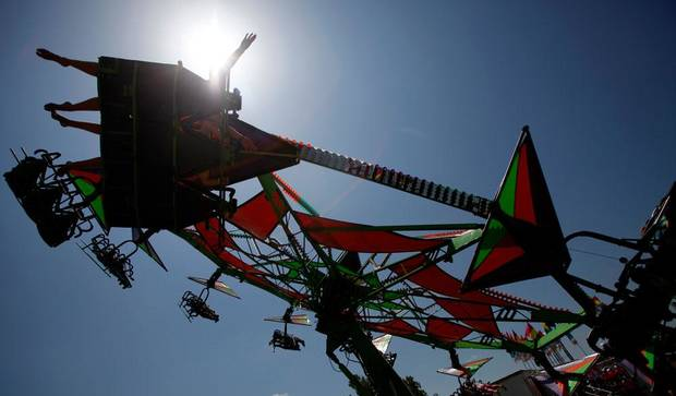 Children ride the Cliff Hanger during Freedom Festival at Eldon Lyon Park in Bethany, Wednesday, July 4, 2012. Photo By Steve Gooch, The Oklahoman