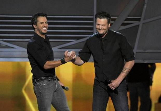 "Luke Bryan, left, and Oklahoma country music superstar Blake Shelton appear on stage during the 2013 Academy of Country Music Awards. The pair, affectionately dubbed ""Bluke,"" will return to co-host the 2014 show Sunday on CBS. (AP file)"