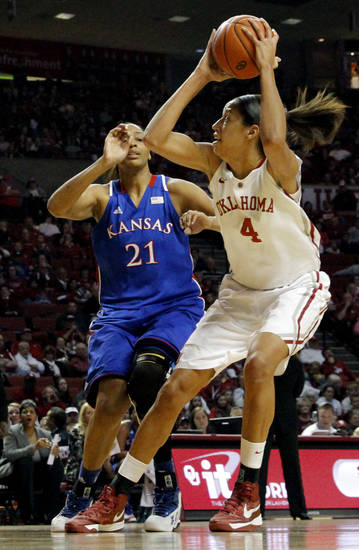 Oklahoma Sooner&#039;s Nicole Griffin (4) shoots in front of Kansas Jayhawks&#039; Carolyn Davis (21) as the University of Oklahoma Sooners (OU) play the Kansas Jayhawks in NCAA, women&#039;s college basketball at The Lloyd Noble Center on Saturday, March 2, 2013  in Norman, Okla. Photo by Steve Sisney, The Oklahoman
