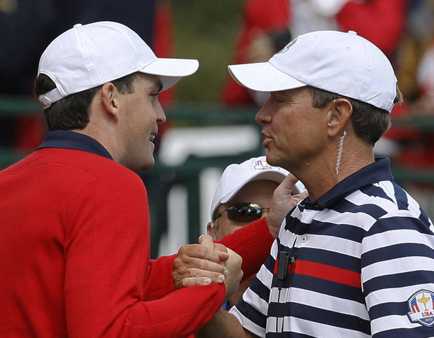 USA's captain Davis Love III, right, talks to Keegan Bradley on the first tee before a singles match at the Ryder Cup PGA golf tournament Sunday, Sept. 30, 2012, at the Medinah Country Club in Medinah, Ill. (AP Photo/Charles Rex Arbogast)  ORG XMIT: PGA104