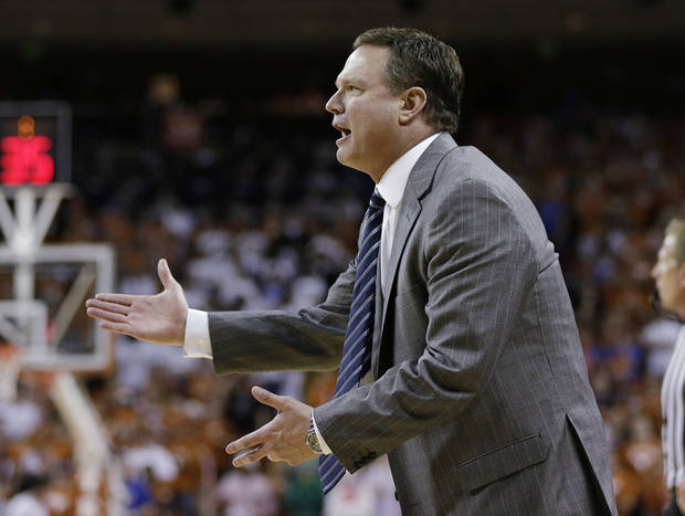 Kansas coach Bill Self talks to his players during the first half of an NCAA college basketball game against Texas, Saturday, Jan. 19, 2013, in Austin, Texas. Kansas won 64-59. (AP Photo/Eric Gay) ORG XMIT: TXEG117