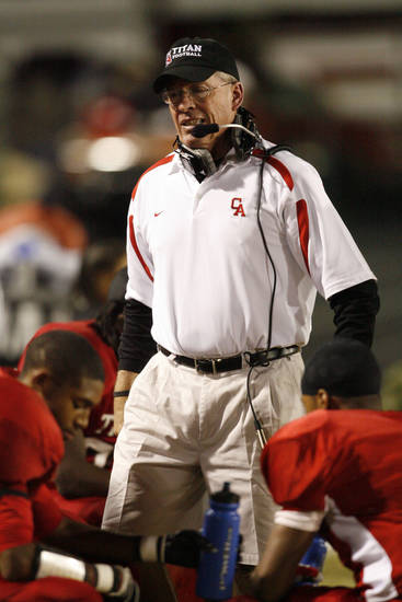 Head coach Gary Rose talks with his defense as Carl Albert plays Guthrie in high school football at Jim Harris Stadium  in Midwest City, Oklahoma on Thursday October 16, 2008.  