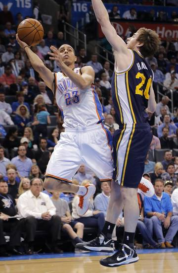 Oklahoma City Thunder's Kevin Martin (23) shoots around Utah Jazz's Gordon Hayward (20) during the NBA basketball game between the Oklahoma City Thunder and the Utah Jazz at Chesapeake Energy Arena on Wednesday, March 13, 2013, in Oklahoma City, Okla. Photo by Chris Landsberger, The Oklahoman
