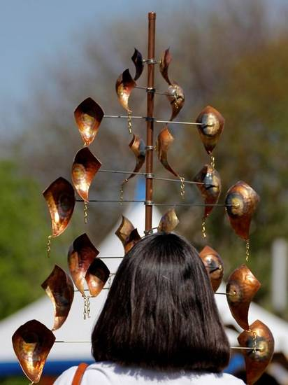 A woman watches a kinetic sculpture during the last day of the Festival of the Arts, Sunday, April 28, 2013.  Photo by Doug Hoke, The Oklahoman