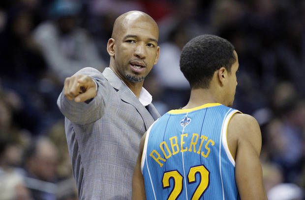 New Orleans Hornets coach Monty Williams, left, talks to Brian Roberts during the first half of an NBA basketball game against the Memphis Grizzlies in Memphis, Tenn., Sunday, Jan. 27, 2013. (AP Photo/Danny Johnston)