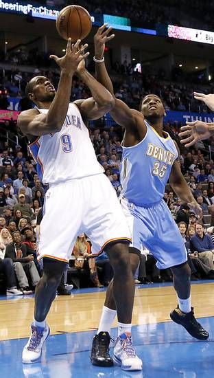Oklahoma City's Serge Ibaka (9) fights for the ball with Denver's Kenneth Faried (35) during the NBA basketball game between the Oklahoma City Thunder and the Denver Nuggets at the Chesapeake Energy Arena on Wednesday, Jan. 16, 2013, in Oklahoma City, Okla.  Photo by Chris Landsberger, The Oklahoman