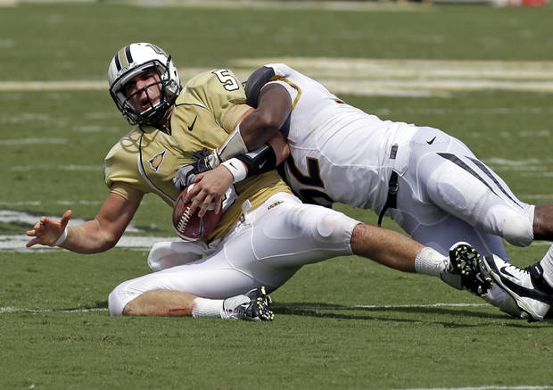 Central Florida quarterback Blake Bortles, left, is sacked by Missouri defensive lineman Michael Sam during the first half of an NCAA college football game, Saturday, Sept. 29, 2012, in Orlando, Fla. (AP Photo/John Raoux)