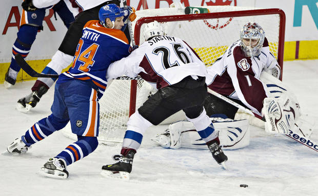 Colorado Avalanche goalie Semyon Varlamov makes the save as Paul Stastny (26) and Edmonton Oilers' Ryan Smyth battle for the rebound during the first period of their NHL hockey game, Monday, Jan. 28, 2013, in Edmonton, Alberta. (AP Photo/The Canadian Press, Jason Franson)