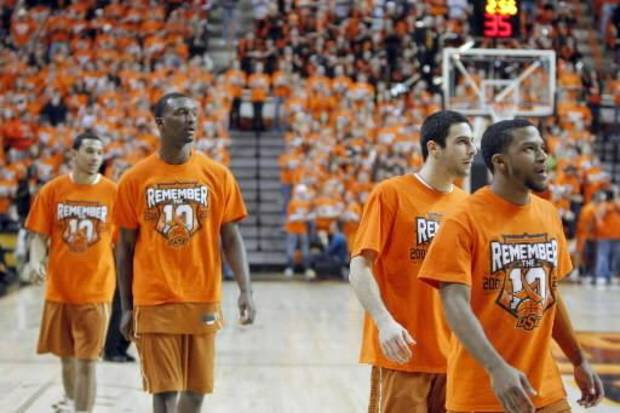 Texas players warm up wearing &quot;Remember the 10&quot; T-shirts before the basketball game between Oklahoma State and Texas, Wednesday, Jan. 26, 2011, Stillwater, Okla. Photo by Sarah Phipps,