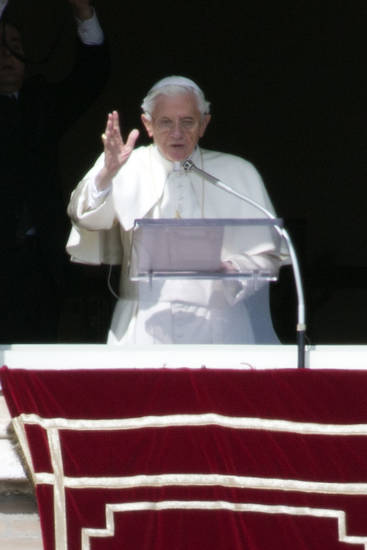 Pope Benedict XVI delivers his blessing during his last Angelus noon prayer, from the window of his studio overlooking St. Peter's Square, at the Vatican, Sunday, Feb. 24, 2013. Benedict XVI gave his pontificate's final Sunday blessing from his studio window to the cheers of tens of thousands of people packing St. Peter's Square, but sought to reassure the faithful that he wasn't abandoning the church by retiring to spend his final years in prayer. The 85-year-old Benedict is stepping down on Thursday evening, the first pope to do so in 600 years, after saying he no longer has the mental or physical strength to vigorously lead the world's 1.2 billion Catholics. (AP Photo/Andrew Medichini)