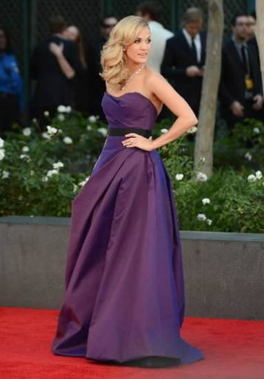Carrie Underwood, wearing Romona Keveza, arrives at the 65th Primetime Emmy Awards at Nokia Theatre on Sunday Sept. 22, 2013, in Los Angeles. (AP)