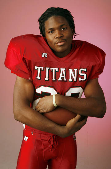 David Oku, Carl Albert, poses for a photo in the OPUBCO studio for The Oklahoman's All-State Football Team, in Oklahoma City, Wednesday, Dec. 12, 2007. By Nate Billings, The Oklahoman