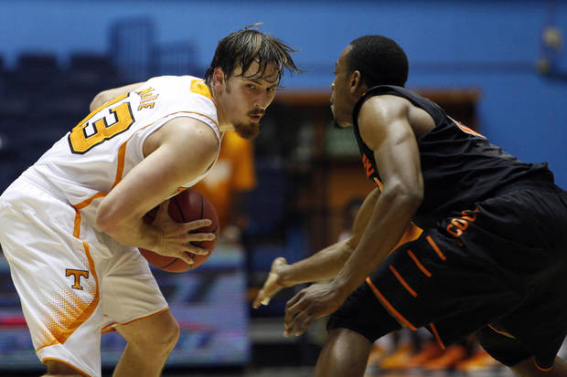 Oklahoma State's Markel Brown, right, pressures Tennessee's Skylar McBee during a NCAA college basketball game in Bayamon, Puerto Rico, Friday, Nov. 16, 2012. (AP Photo/Ricardo Arduengo) ORG XMIT: SJU105