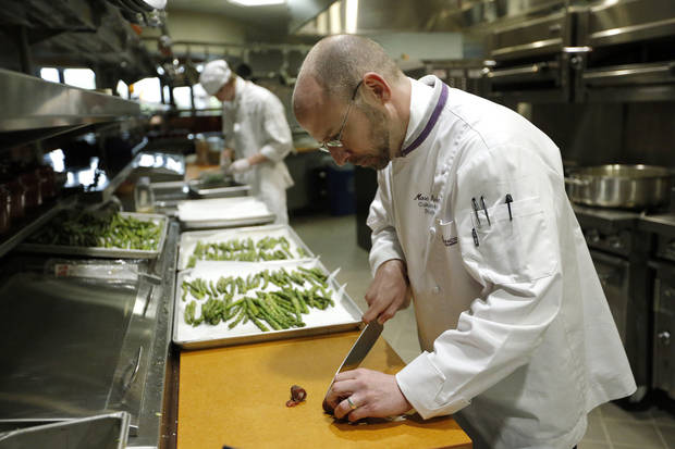 Marc Dunham prepares vegetables in a culinary arts program kitchen at Francis Tuttle Technology Center.  Photo by Sarah Phipps, The Oklahoman <strong>SARAH PHIPPS - SARAH PHIPPS</strong>