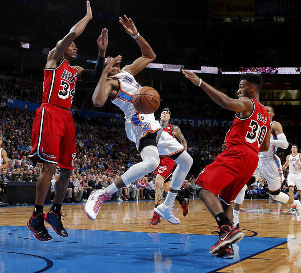 Oklahoma City's Kevin Durant (35) loses the ball between Miami's Ray Allen (34) and Norris Cole (30) during an NBA basketball game between the Oklahoma City Thunder and the Miami Heat at Chesapeake Energy Arena in Oklahoma City, Thursday, Feb. 15, 2013. Miami won 110-100. Photo by Bryan Terry, The Oklahoman