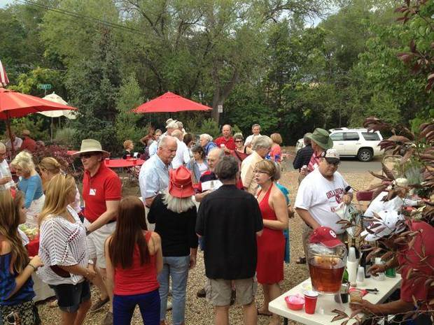 Members of the OU Alumni Club of Santa Fe and their guests enjoyed the Sooner barbecue in the Santa Fe home of John R. McKee. (Photo provided).