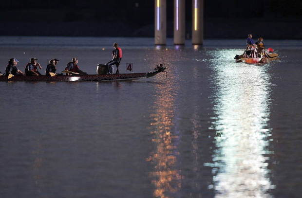 Dragon boats paddle down the Oklahoma River during the Oklahoma Regatta Festival Night Sprints in Oklahoma City, Thursday, Sept. 27, 2012.  Photo by Garett Fisbeck, The Oklahoman