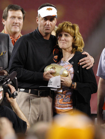 Oklahoma State coach hugs Shelley Budke after winning the Fiesta Bowl between the Oklahoma State University Cowboys (OSU) and the Stanford Cardinal at the University of Phoenix Stadium in Glendale, Ariz., Tuesday, Jan. 3, 2012. Photo by Bryan Terry, The Oklahoman