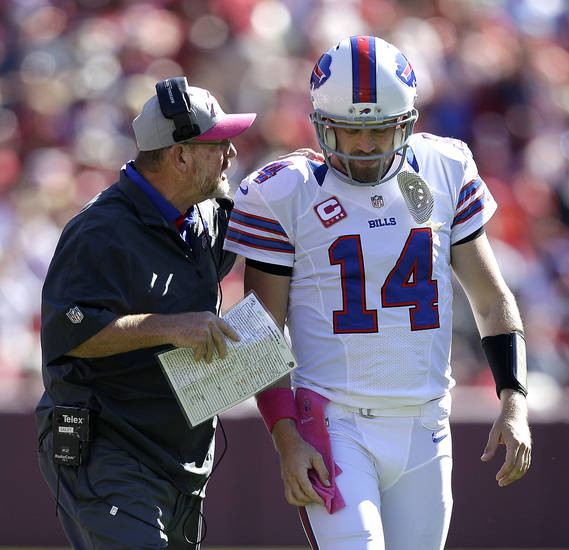 Buffalo Bills head coach Chan Gailey talks with quarterback Ryan Fitzpatrick (14) during the second quarter of an NFL football game against the San Francisco 49ers, Sunday, Oct. 7, 2012, in San Francisco. (AP Photo/Ben Margot)