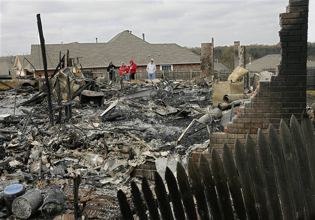 Residents  get a look at their home  that was destroyed in Thursday's wildfires in the Oakwood East Royale neighborhood in Midwest City  Friday, April 10, 2009. Photo by Jim Beckel, The Oklahoman