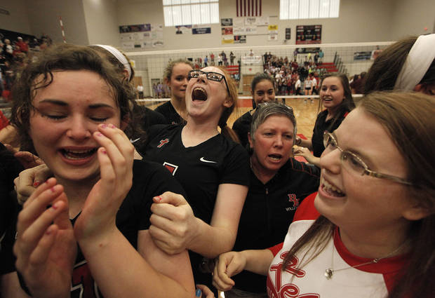 Liza Hepner, left, becomes emotional as she celebrates with her teammates after winning the OSSAA 6A State Volleyball Championship between Bishop Kelley and Edmond Memorial at Westmoore High School in Moore, Okla., Saturday, Oct. 13, 2012.  Photo by Garett Fisbeck, The Oklahoman