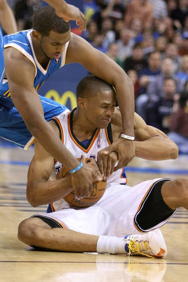OKLAHOMA CITY THUNDER / NEW ORLEANS HORNETS / NBA BASKETBALL  New Orleans' guard Chris Paul fights for the ball with Oklahoma City Thunder guard Russell Westbrook during the Thunder - Hornets game January 6, 2010 in the Ford Center in Oklahoma City.    BY HUGH SCOTT, THE OKLAHOMAN ORG XMIT: KOD
