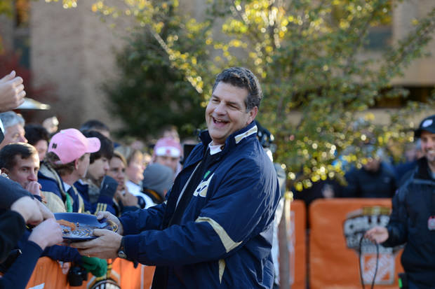 "Mike Golic jokes with Notre Dame fans on the set of ESPN's ""College GameDay"" on Oct. 13 at South Bend, Ind. <strong>Allen Kee - ESPN photo</strong>"