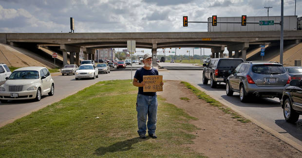 Raymond Hauser, 50, of Joplin, Mo. panhandles as he works the intersection at I-40 and MacArthur Blvd. on Wednesday, Sept. 26, 2012, in Oklahoma City, Okla. Hauser ended up in Oklahoma after being stranded while hitchhiking to California a month ago.  Photo by Chris Landsberger, The Oklahoman
