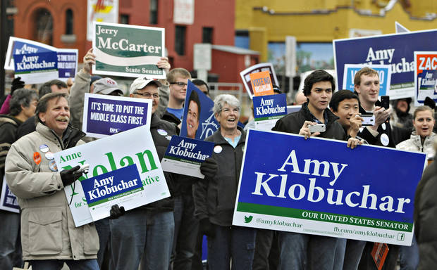 Supporters hold signs for a DFL rally near the River's Edge Convention Center in St. Cloud, Minn., Saturday, Nov. 3, 2012. (AP Photo/The St. Cloud Times, Dave Schwarz) NO SALES