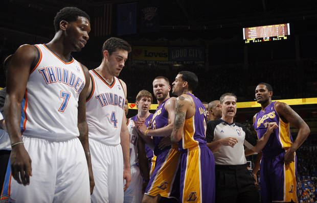 Oklahoma City's Royal Ivey (7) and Nick Collison (4) walk to the Thunder bench as Los Angeles' Troy Murphy (14), Josh McRoberts (6), Matt Barnes (9) and Devin Ebanks (3) argue during Game 1 in the second round of the NBA playoffs between the Oklahoma City Thunder and the L.A. Lakers at Chesapeake Energy Arena in Oklahoma City, Monday, May 14, 2012. Photo by Sarah Phipps, The Oklahoman