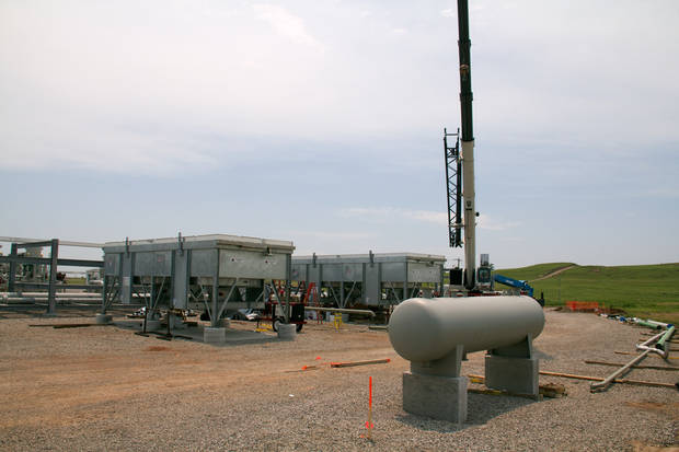Chaparral Energy compressors compresses carbon dioxide recovered from producing wellsbefore it is reinjected into the rock layers underground.  <strong>photo by Adam Wilmoth</strong>