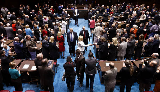 Arizona Gov. Jan Brewer leaves the Arizona House of Representatives floor after she gives her State of the State address at the Arizona Capitol, Monday, Jan. 14, 2013, in Phoenix. (AP Photo/Ross D. Franklin)