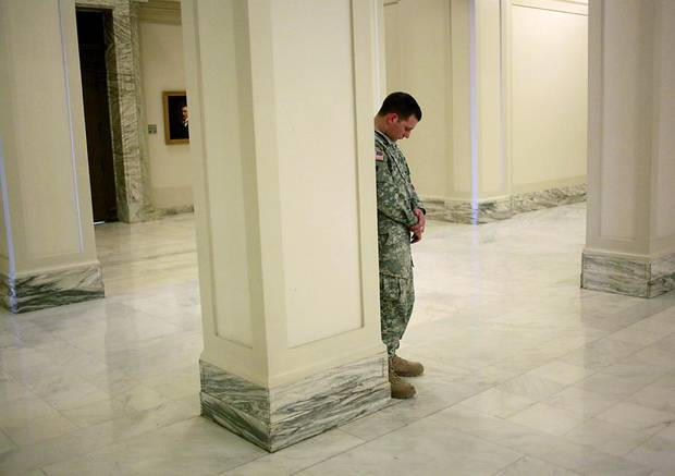First Lieutenant Montana Dugger, with the Oklahoma National Guard, bows his head in prayer during the National Day of Prayer at the Oklahoma State Capitol in Oklahoma City on May 5, 2011. Photo by John Clanton, The Oklahoman