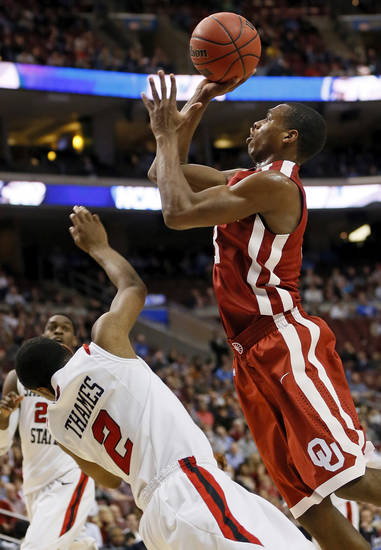 Oklahoma's Buddy Hield (3) is called for a charge against San Diego State's Xavier Thames (2) during a game between the University of Oklahoma and San Diego State in the second round of the NCAA men's college basketball tournament at the Wells Fargo Center in Philadelphia, Friday, March 22, 2013. Photo by Nate Billings, The Oklahoman