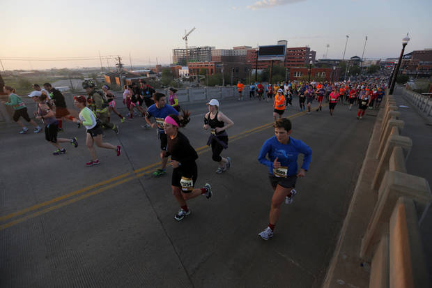 Runners make their way north on the Walnut Ave. bridge during the Oklahoma City Memorial Marathon in Oklahoma City, Sunday, April 28, 2013.  Photo by Garett Fisbeck, For The Oklahoman