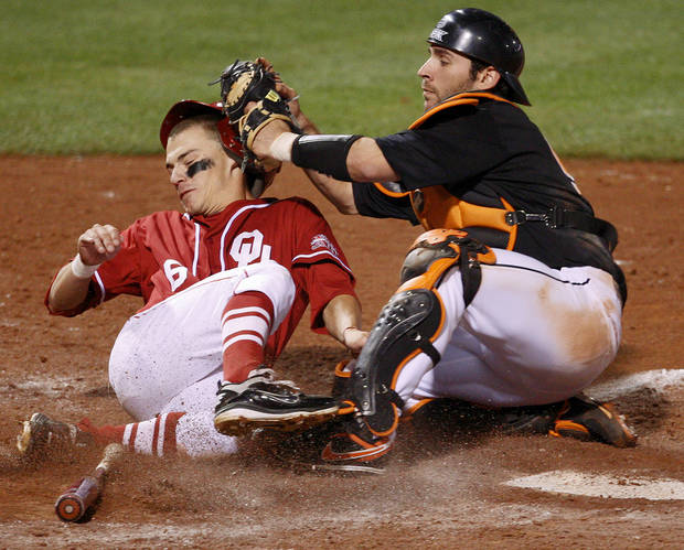 OSU's Jared Womack tags out OU's Eric Ross at home in the seventh inning of the Bedlam college baseball game between the University of Oklahoma and Oklahoma State University at RedHawks Field at Bricktown in Oklahoma City, Saturday, April 16, 2011. Photo by Bryan Terry, The Oklahoman