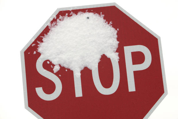 A snow plastered stop sign on the University of Central Oklahoma campus in Edmond Monday, Feb. 13, 2012. Because of the weather Monday UCO was closed and classes delayed until 10am. Photo by Paul B. Southerland, The Oklahoman