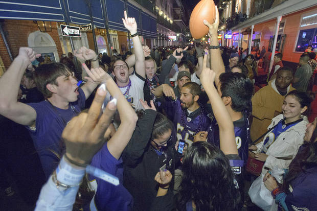 Baltimore Ravens fans celebrate the team's victory as fans from the Ravens and San Francisco 49ers NFL football teams pack the French Quarter on Bourbon Street for Super Bowl XLVII near the Royal Sonesta Hotel in New Orleans, Sunday, Feb. 3, 2013. (AP Photo/Matthew Hinton)