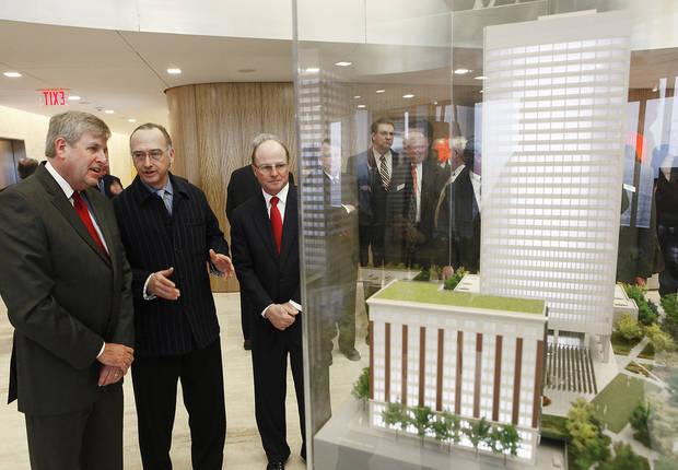 Oklahoma City Manager Jim Couch, architect Rob Rogers and SandRidge CEO Tom Ward look over a model of the planned campus makeover, Thursday, January 28, 2010. Photo by David McDaniel, The Oklahoman <strong>David McDaniel - The Oklahoman</strong>