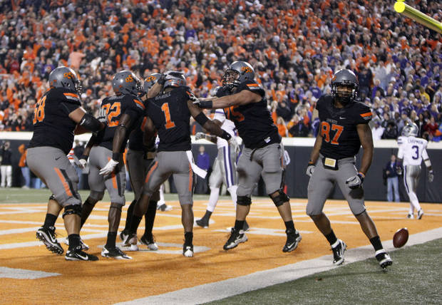 Oklahoma State celebrates Oklahoma State's Joseph Randle (1) game-winning touchdown during a college football game between the Oklahoma State University Cowboys (OSU) and the Kansas State University Wildcats (KSU) at Boone Pickens Stadium in Stillwater, Okla., Saturday, Nov. 5, 2011.  Photo by Sarah Phipps, The Oklahoman