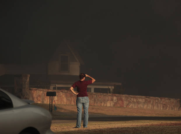 A resident looks at the smoke building in a large wildfire in Luther, Okla., Friday, Aug. 3, 2012. Photo by Sarah Phipps, The Oklahoman