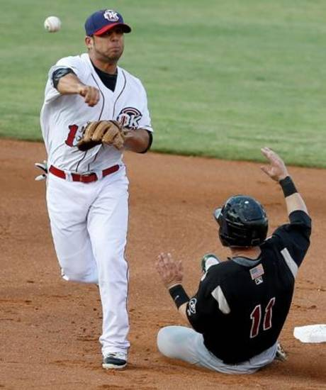 Jose Martinez of the Oklahoma City RedHawks throws over Daric Barton of the Sacramento River Cats to complete the double play in the second inning at Chickasaw Bricktown Ballpark in Oklahoma City, Friday, August 10, 2012. Photo by Bryan Terry, The Oklahoman Archives