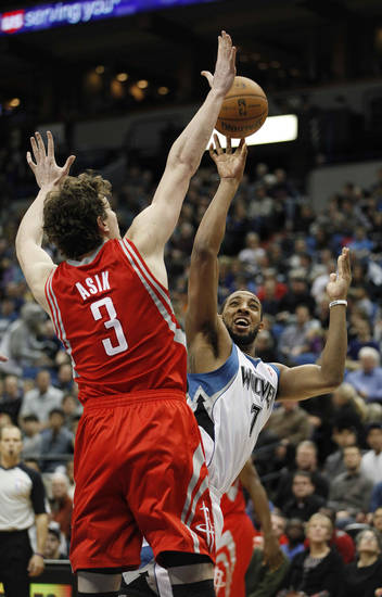 Minnesota Timberwolves forward Derrick Williams (7) shoots against Houston Rockets center Omer Asik (3) in the first half of an NBA basketball game on Saturday, Jan. 19, 2013, in Minneapolis. (AP Photo/Stacy Bengs)